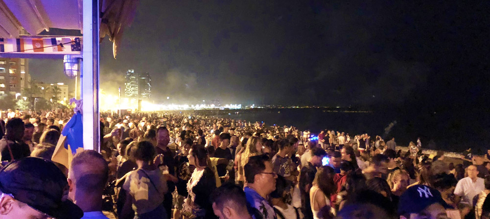 La Noche de San Juan Barcelona, Barceloneta beach full of happy people