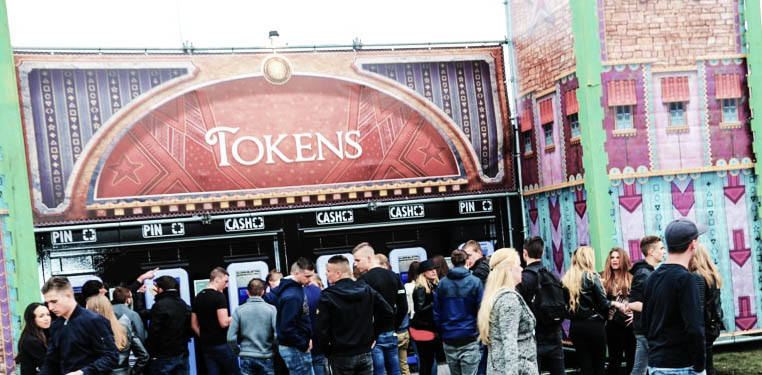 Photo of Tokens Shop with a few people